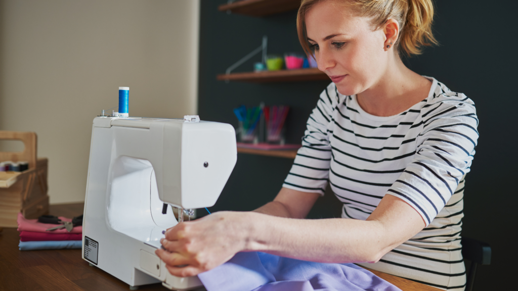 Photo of a woman sewing with a sewing machine