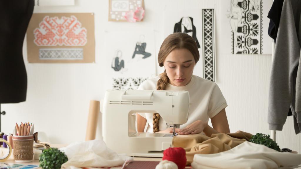 A woman sewing using a mini sewing machine