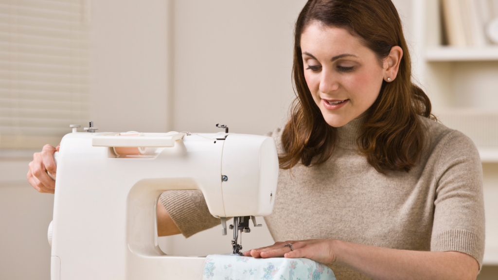 A woman sewing with a sewing machine