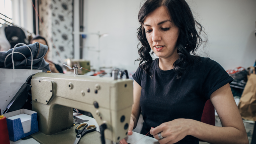A woman threading her machine