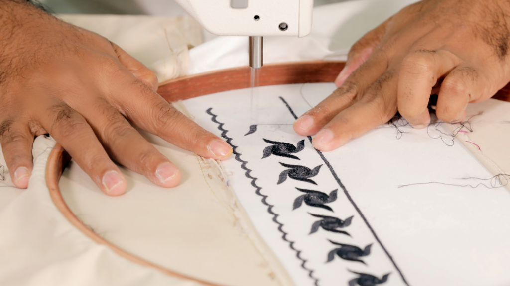 A person doing embroidery with a machine
